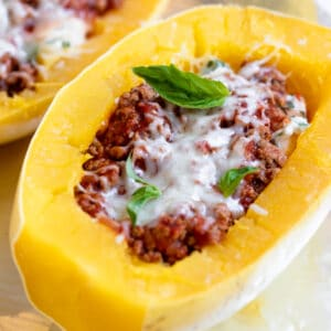 A close up of spaghetti squash with meat sauce