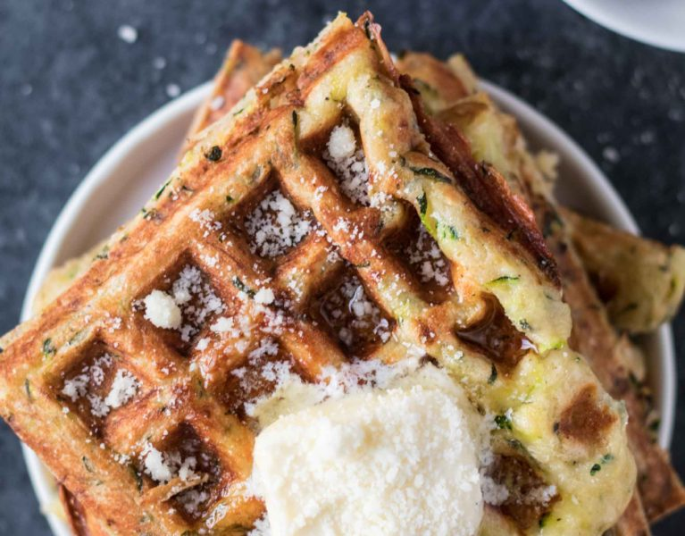 Zucchini Parmesan Waffles are a delicious way to celebrate National Waffle Day today! krollskorner.com