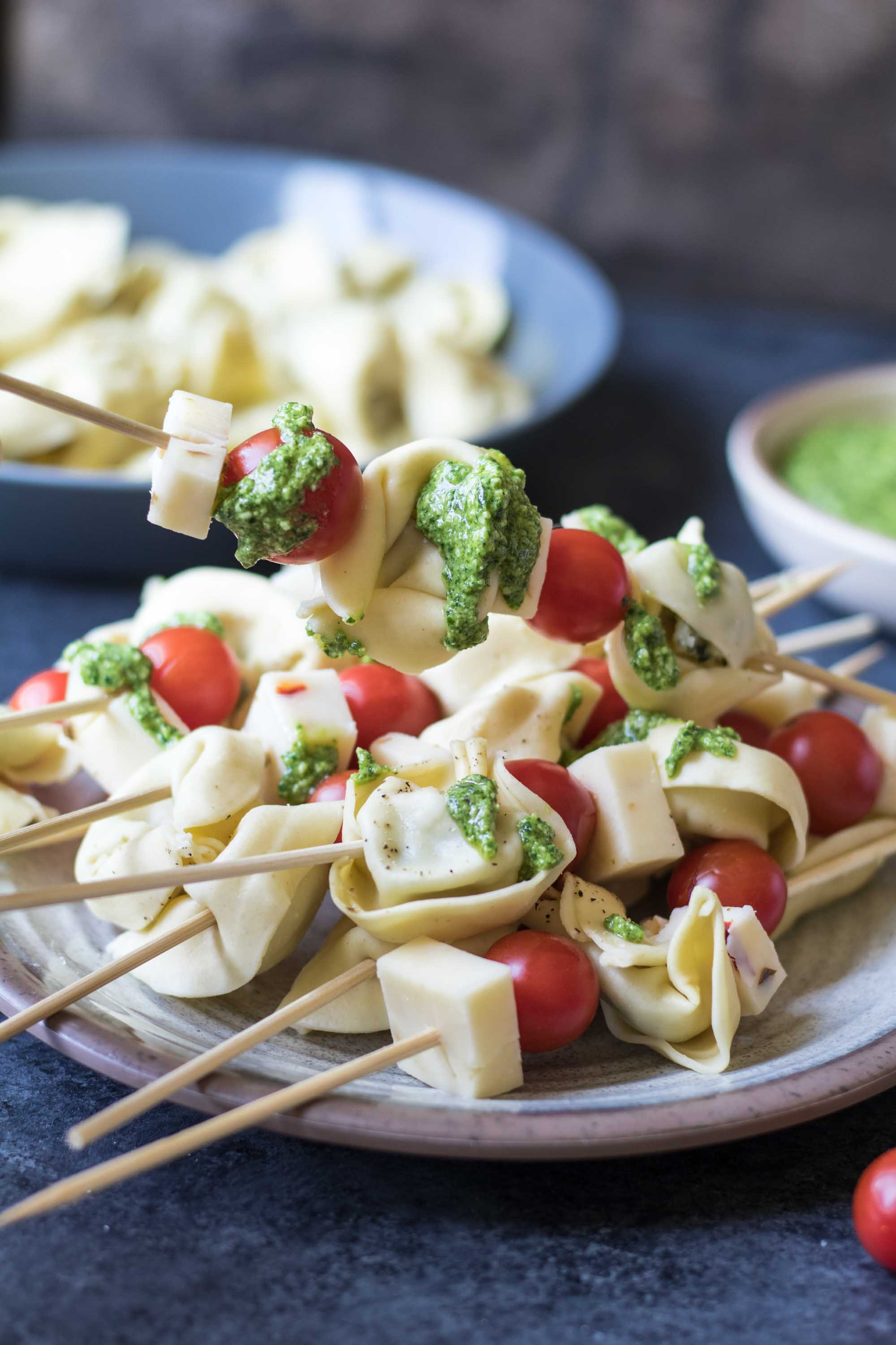 These tortellini skewers with lemon spinach pesto are a perfect light and satisfying appetizer! | Krollskorner.com