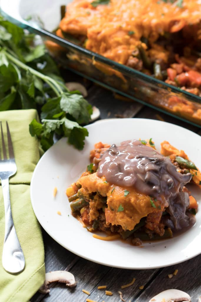 This healthy shepherd's pie is layered with ground turkey and veggies topped with whipped sweet potatoes and a savory mushroom gravy. |Krollskorner.com