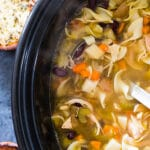 a slow cooker filled with chicken noodle soup