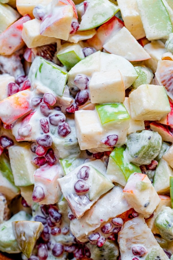fruit mixed together - pomegranates, blood oranges, apples with greek yogurt dressing