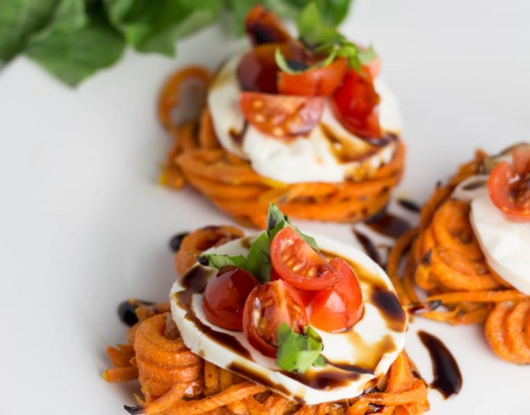 This appetizer is a fun way to incorporate spiralized veggies & an easy way to impress your guests! The combo of fresh mozzarella and basil is always a win! |Krollskorner.com