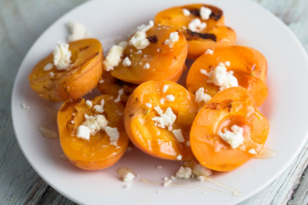 grilled apricots on a white plate