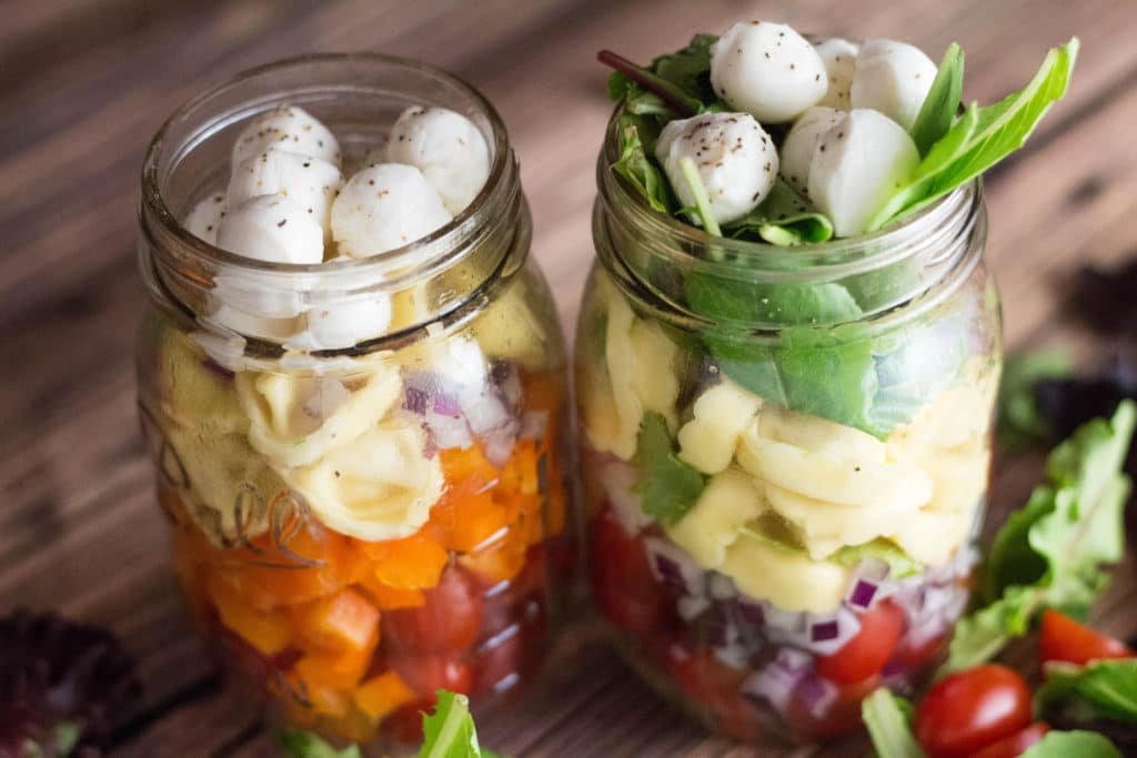 Tortellini Mason Jar Salad. Perfect for lunches on the go, ditch the fast food salad loaded with hidden calories and grams of fat!  krollskorner.com