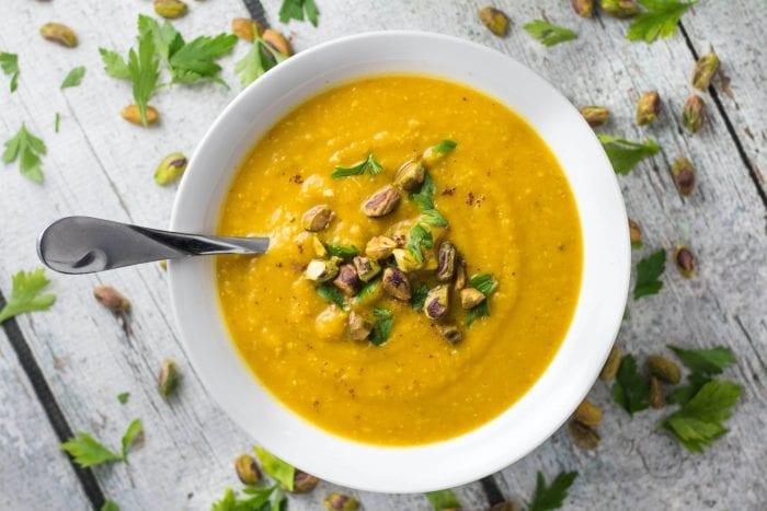 pistachio soup in a white bowl