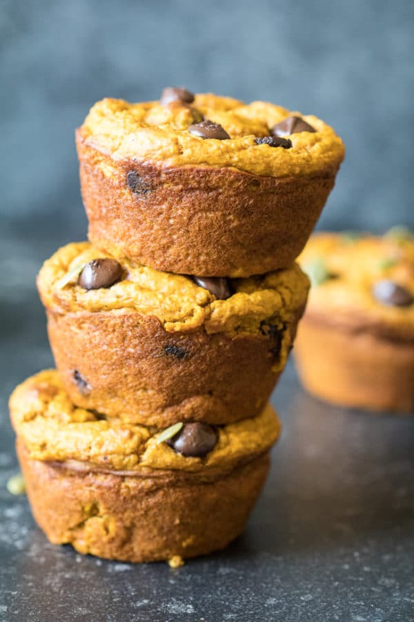 Pumpkin muffins with chocolate chips stacked on top of eachother