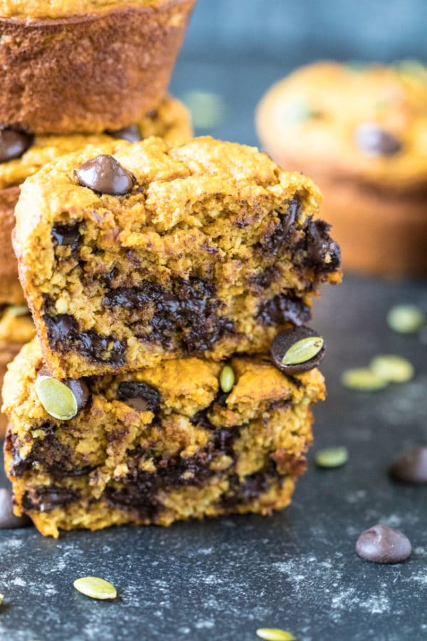 Pumpkin muffins cut in half with melty chocolate chips