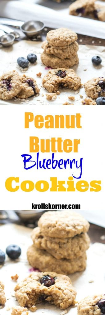 Peanut butter blueberry cookies on parchment paper with measuring spoons and blueberries