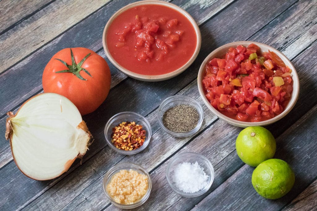 This 10 Minute Vitamix Salsa can be whipped up in 10 minutes or less! In the height of tomato season, this salsa is a must - plus with homemade tortilla chips you can't go wrong! |Krollskorner.com