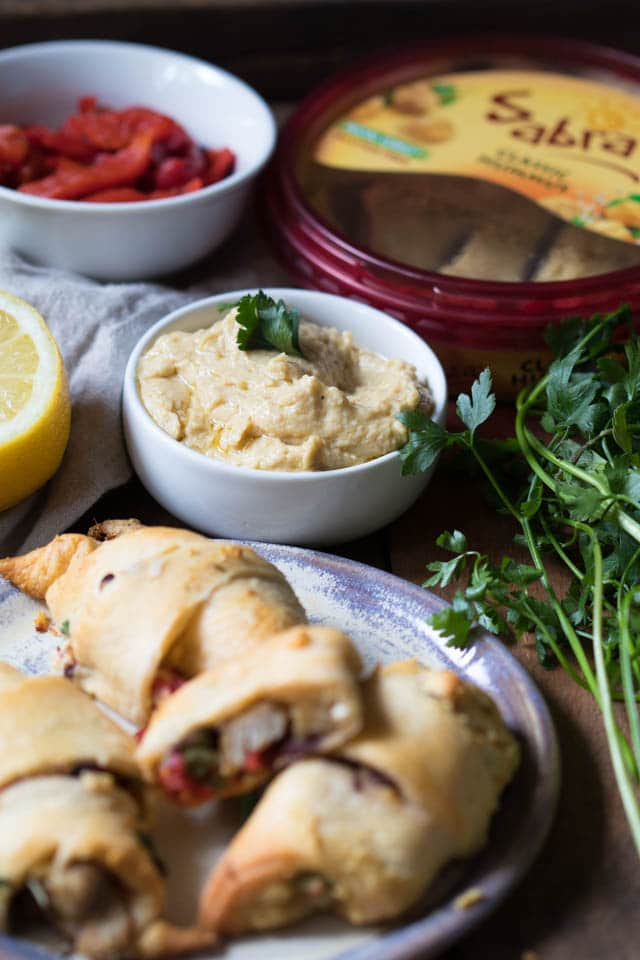 #AD Celebrate National Hummus Day May 13th with this easy Crescent Wrapped Mediterranean Chicken appetizer! #Sponsored