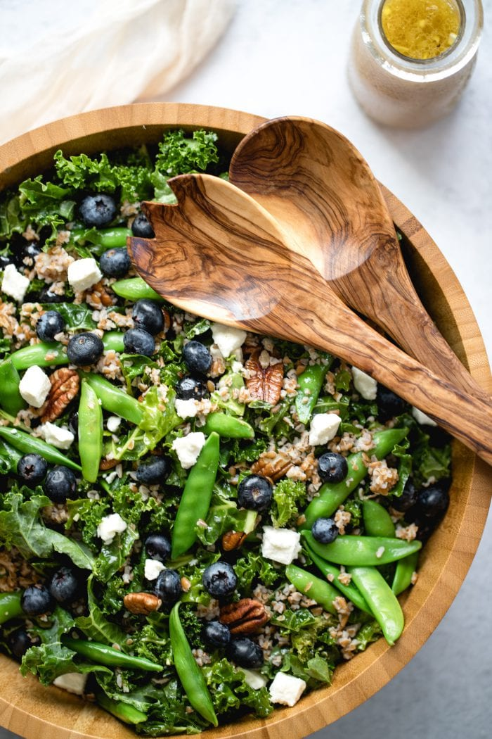 kale salad in a wood bowl
