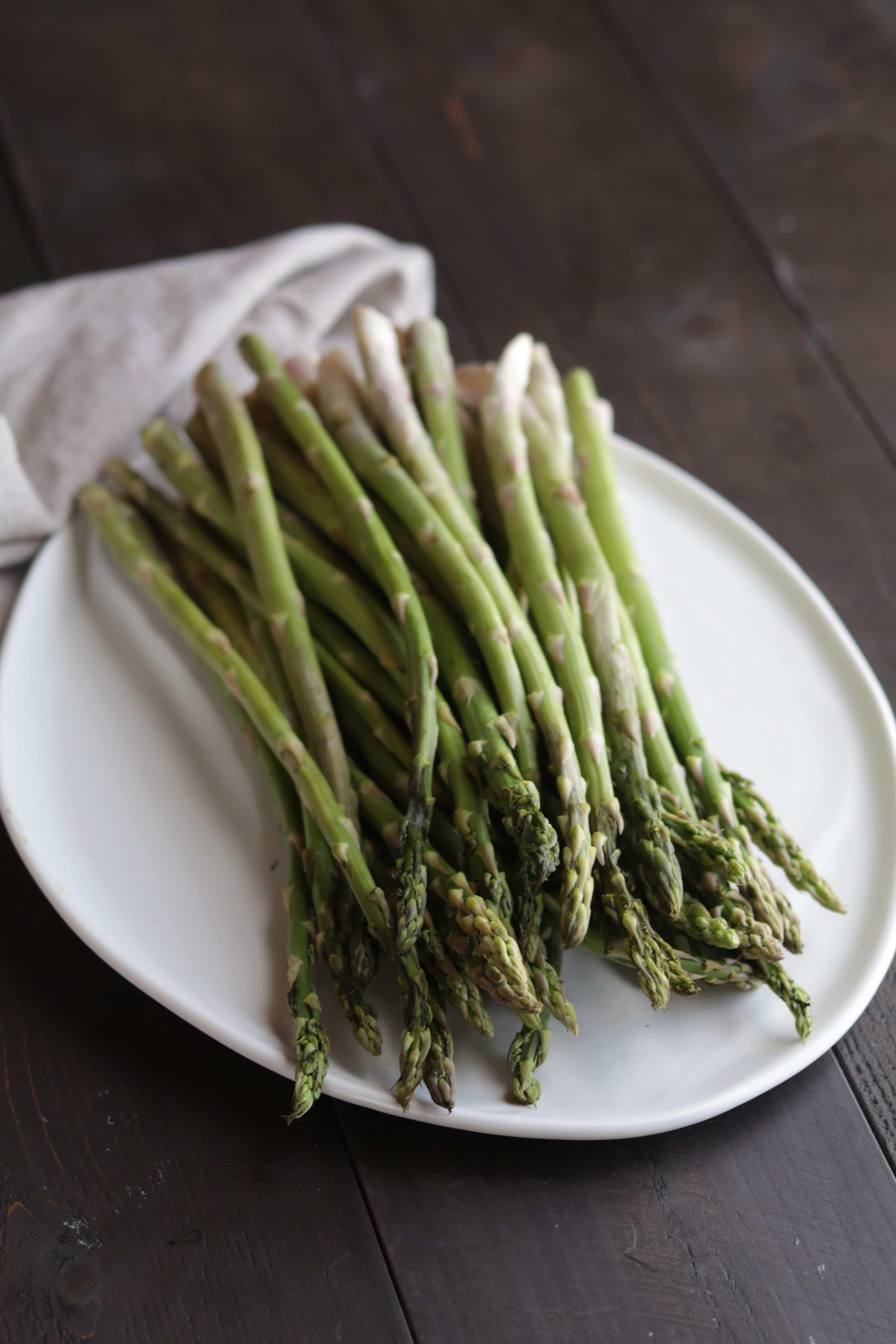a white plate with asparagus on it