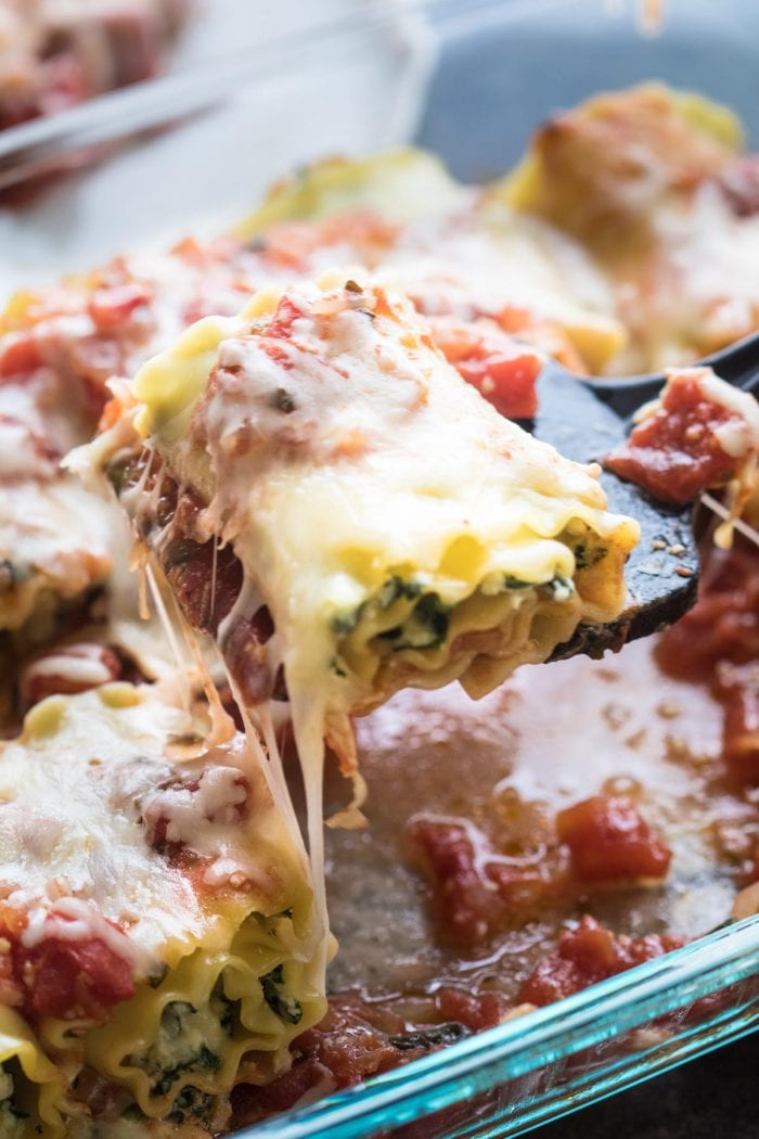 Celebrate National Lasagna Day with these Cheesy Spinach Lasagna Roll Ups! krollskorner.com