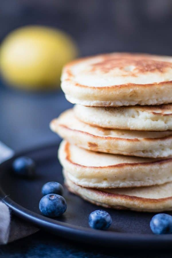 Lemon Soufflé Pancakes with Blueberry Maple Syrup - a pancake recipe you CANNOT miss out on! krollskorner.com