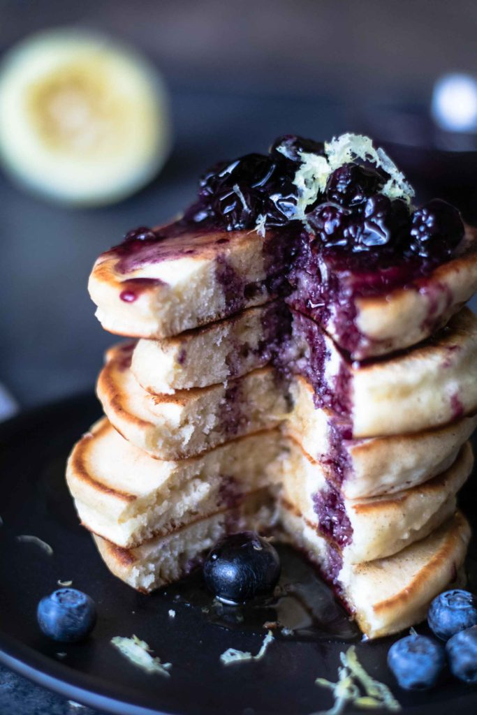 Lemon Soufflé Pancakes with Blueberry Maple Syrup - a pancake recipe you CANNOT miss out on! |krollskorner.com
