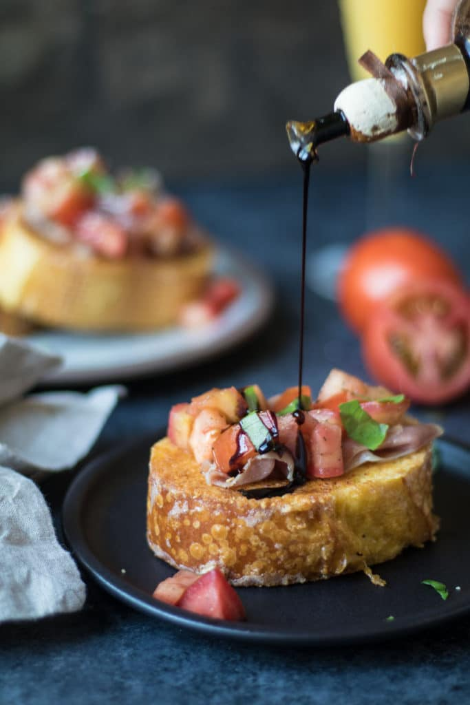 Bruschetta French Toast with Parmesan Crust is a fun savory way to enjoy traditional french toast for breakfast or brunch! krollskorner.com