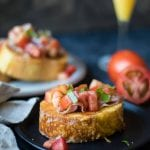 Bruschetta French Toast with Parmesan Crust is a fun savory way to enjoy traditional french toast for breakfast or brunch!krollskorner.com