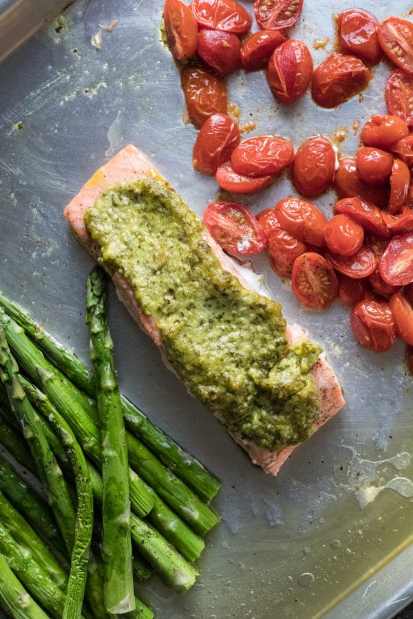 Sheet Pan meals are a fantastic way to make weeknight meal times easy and nutritious! Plus, clean up is a breeze! Try this sheet pan pesto salmon out today! krollskorner.com