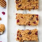 homemade granola bars on an off white plate