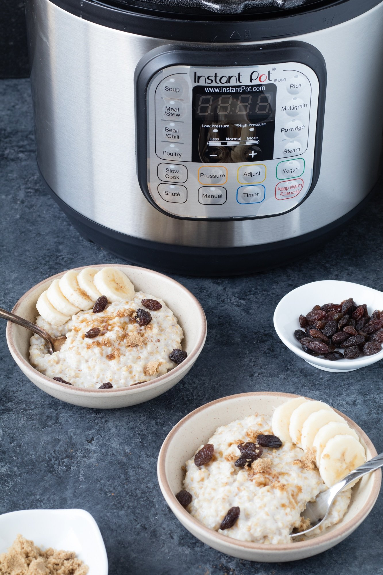 two bowls of instant pot steel cut oats in front of an Instant Pot