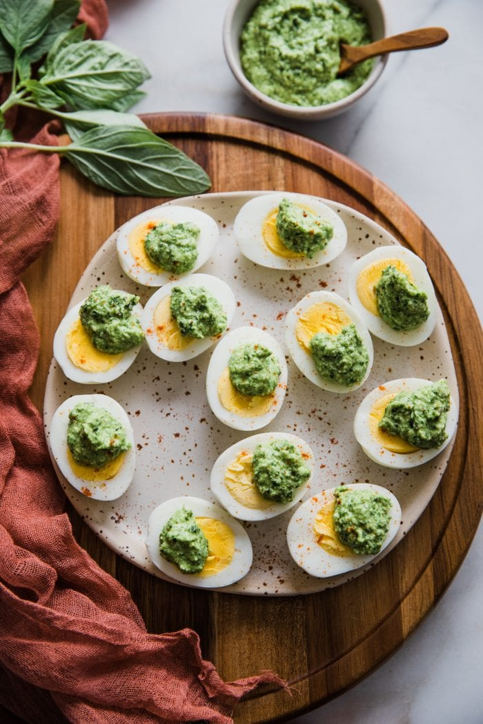 hard boiled eggs with parmesan pesto over them