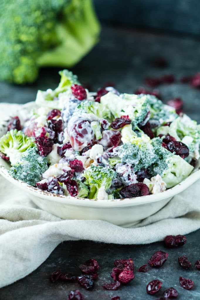 Dried Cranberry Broccoli Salad is a nutrient rich & satisfying Spring time side dish! The Dried Cranberries add a beautiful pop of color, fiber, and vitamin C! krollskorner.com