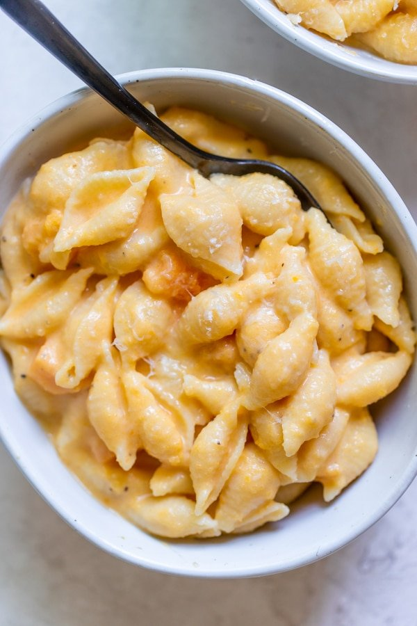 butternut squash mac and cheese in a white bowl
