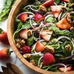 spinach in a wood bowl with stawberries