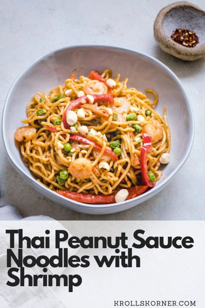 Thai Peanut Noodles in a bowl with red pepper chili flakes and a napkin