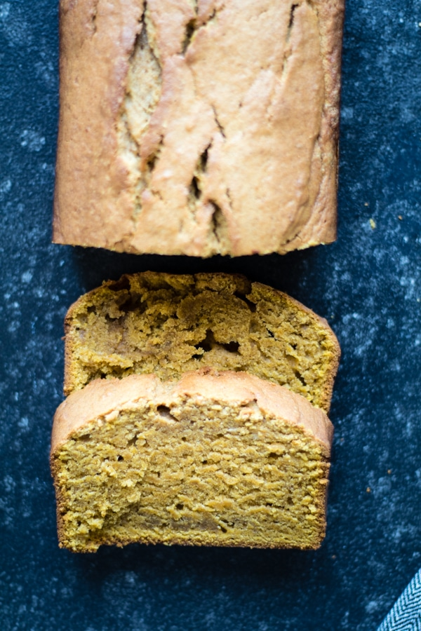 Sliced Pound Cake made with pumpkin on a board.