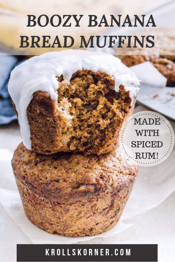 Two muffins stacked on top of each other. Top muffin has frosting on it.