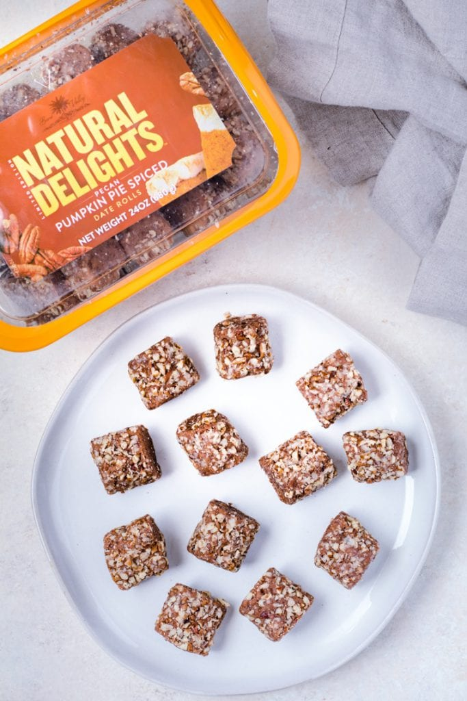 Natural Delights® Pecan Pumpkin Pie Spice Date Rolls on a white plate.