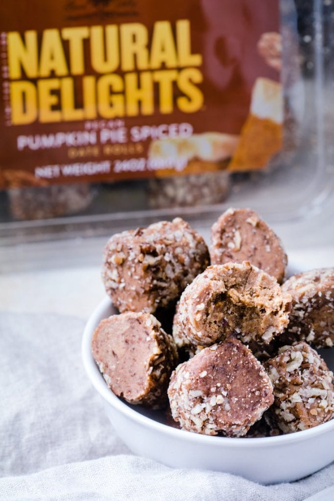 Natural Delights® Pecan Pumpkin Pie Spice Date Rolls in a white bowl on a napkin.