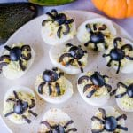 Halloween Deviled Eggs on a cream colored plate.