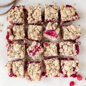 cranberry oatmeal bars on parchment paper