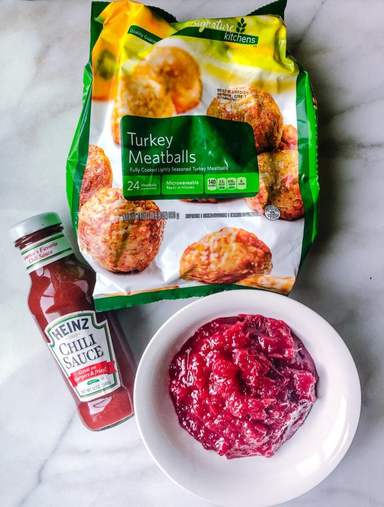 Ingredients for cranberry meatballs on a marble slab