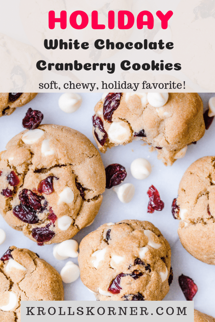 White chocolate cranberry cookies on a marble slab
