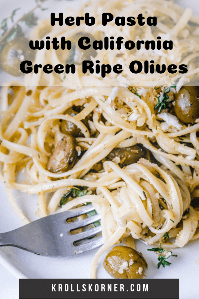 Pasta on a white dish with green olives