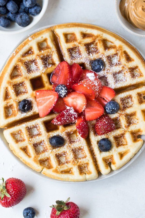 buttermilk waffles on a white plate