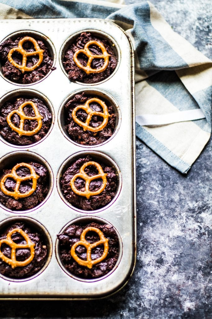 Brownie Bites in a cupcake tin with a pretzel on top