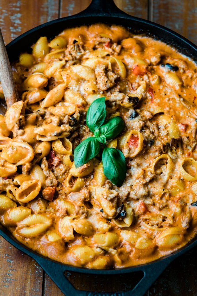 ground turkey pasta in skillet with wooden spoon