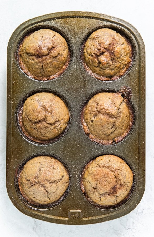 snickerdoodle muffins in a muffin tin