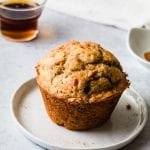 A snickerdoodle muffin on a white plate