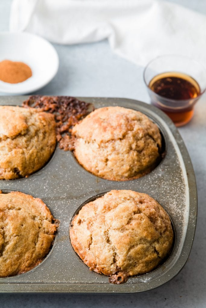 A snickerdoodle muffin in a muffin tin