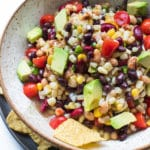 texas caviar in a bowl topped with avocado