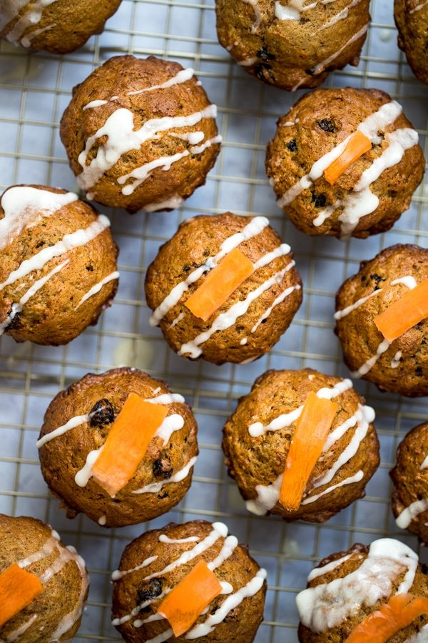 mini carrot cake muffins with glaze on top