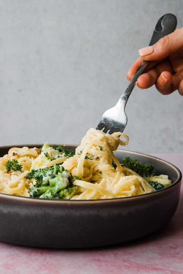 pasta made with a cauliflower sauce in a gray bowl