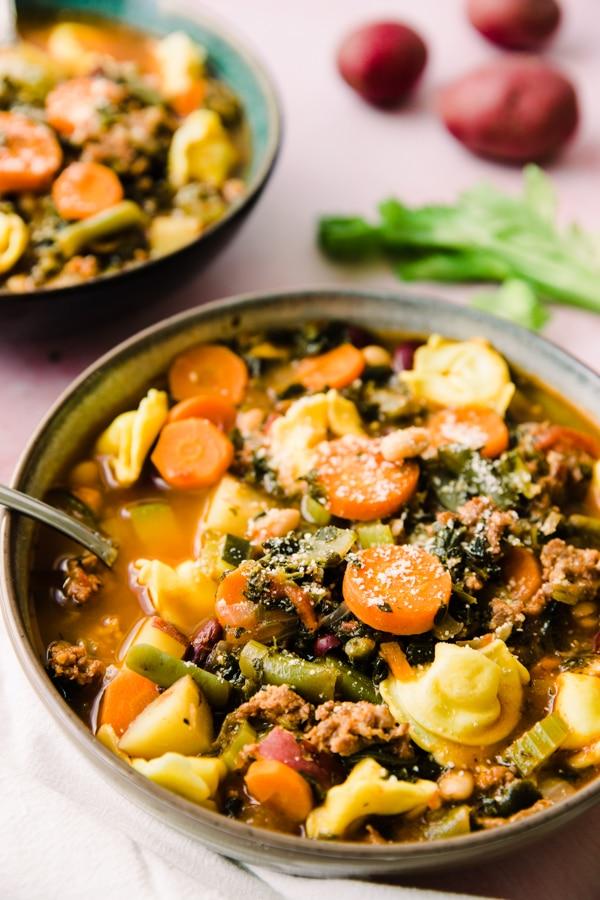 crockpot minestrone soup garnished with parmesan