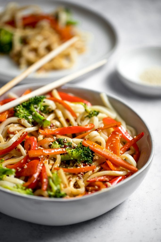 sesame udon noodles in a bowl with chopsticks